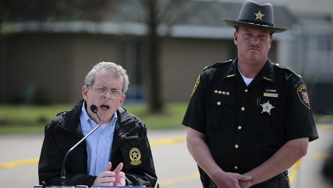 Ohio Attorney General Mike DeWine and Pike County Sheriff Charles Reader spoke at a press conference on the Rhoden murders at the makeshift command center in Waverly on April 27.