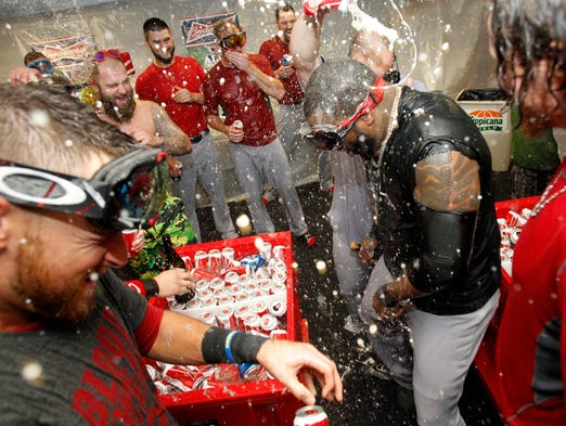 Game 4 -- The Red Sox celebrate in the locker room after eliminating the Rays at Tropicana Field.