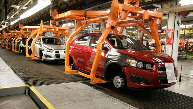 Chevrolet Sonics move down the line at the General Motors Orion Assembly plant in Orion Township, Mich., about 35 miles north of Detroit.