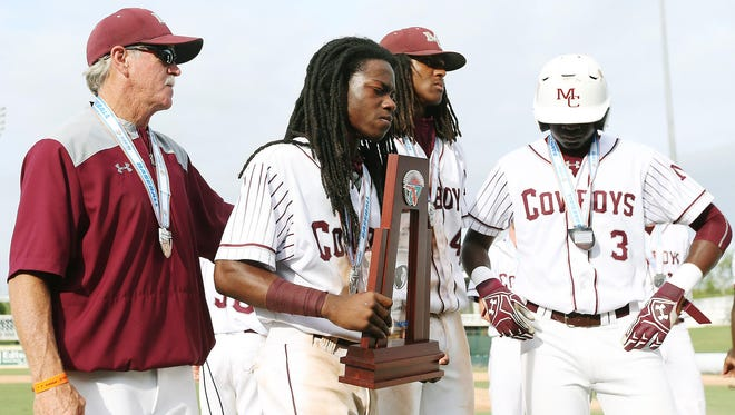 Madison County baseball coach Terry Barrs, left, comforts Mookie Prince, Trey Mitchell and Kris Allen after a 3-2 loss to Trenton on Thursday in the FHSAA Class 1A state championship in Fort Myers.