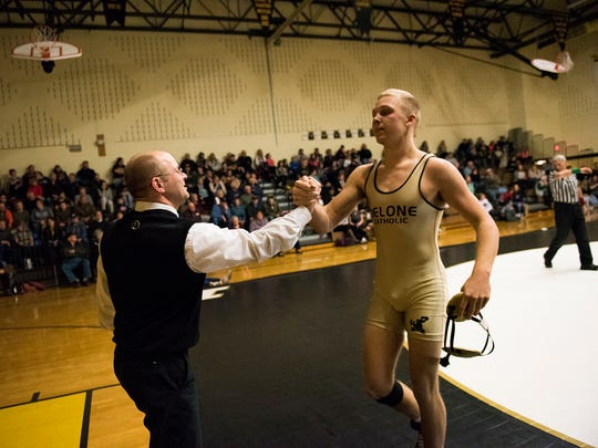 Delone's Brady Repasky is congratulated by head coach Frank Sneeringer after his 0:35 pin against Biglerville's Michael Southerly in the 182-pound bout Tuesday Jan. 19, 2016 at Biglerville High School. Biglerville defeated Delone 44-18.