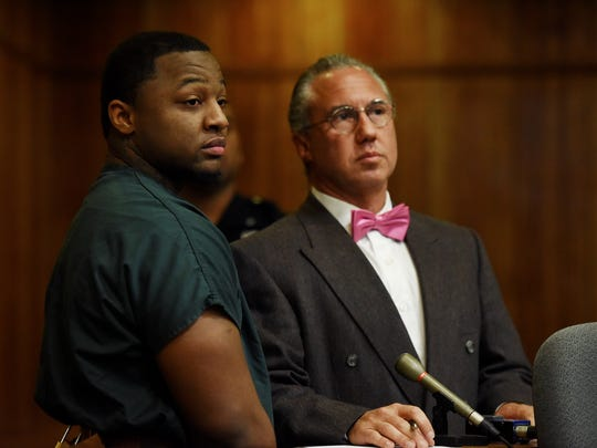 Gregory Oliver, 22, with his attorney Harley Breite,