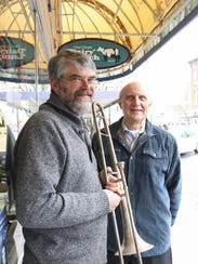 Gary Wallmark, with the vintage trombone, stands with