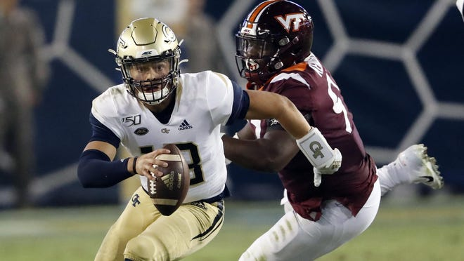 Georgia Tech quarterback Jordan Yates (13) looks for running room against Virginia Tech on Nov. 16, 2019 in Atlanta. Yates is competing with incumbent James Graham and others for the starting job.