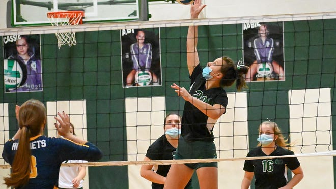 North Adams-Jerome senior Abi Nunez (20) attacks the net during Thursday's match against Hillsdale. Nunez had 18 kills to lead the Rams in their fourth win of the season. Sam Fry/Daily News