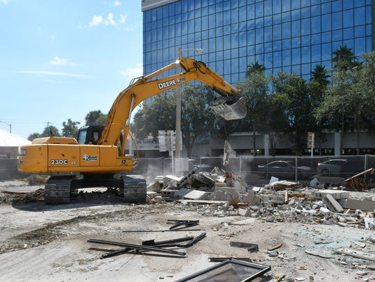 An excavator razes aging structures this week at the