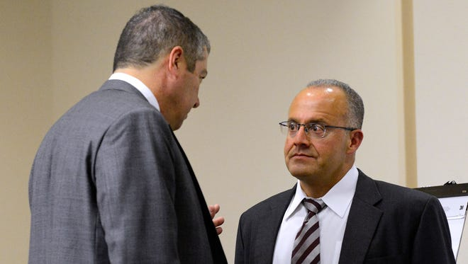 Defense attorneys Sam Bregman, left, and Luis Robles talk during a break during the trial of two former Albuquerque officers, defendants Keith Sandy and Dominique Perez, not seen, in court on Tuesday Sept. 20, 2016 in Albuquerque, N.M. Sandy and Dominique Perez are charged with the 2014 fatal shooting of an armed homeless James Boyd. Defense attorneys have argued that Boyd, who was mentally ill and had history of violence against law enforcement, was a threat.