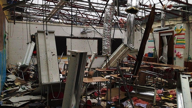 A damaged classroom at Southwestern Middle School in Lafayette, Ind., on Nov. 21, 2013, four days after an EF-2 tornado hit the school.