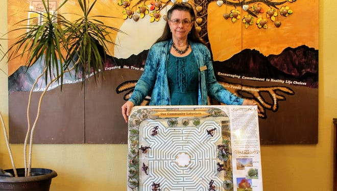 CAPPED Executive Director Tresa VanWinkle stands with a model of the community labyrinth she hopes to accomplish through the help of a community grant from USA Today's ACT program.