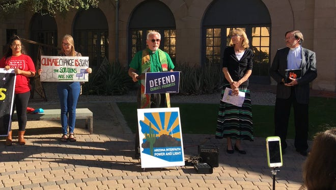 The Rev. Doug Bland, executive director of Arizona Interfaith Power and Light, speaks at press conference on climate change reform on Nov. 14, 2017