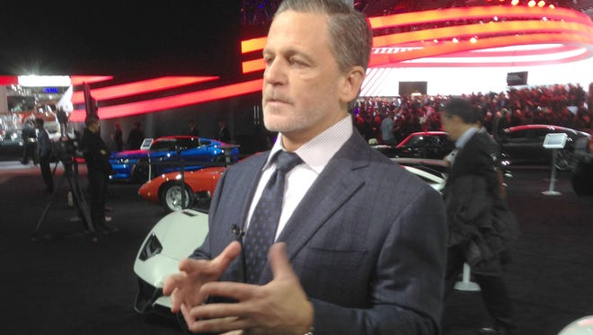 Dan Gilbert talks about cars and his growing businesses including the Robb Report, which has an exhibit at the North American International Auto Show at Cobo Center for the first time this year. on Tuesday, Jan. 12.