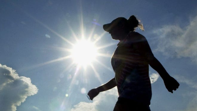 Clouds offer little protection from the sun as Raven Roth exercises at Colorado State University's Jack Christiansen Memorial Track.