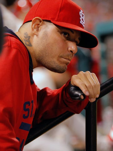 Yadier Molina partially tore ligament on Sept. 20 making