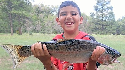 Shawn Molina, 9, of Seboyeta, caught this 22-inch rainbow trout with salmon eggs while fishing at Quemado Lake on Aug. 28.