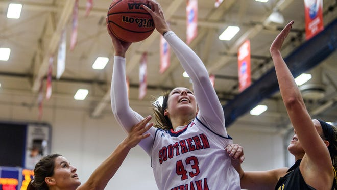 USI's Kacy Eschweiler (43) rebounds the ball during the game against the Ohio Dominican Panthers at USI's Physical Activities Center in Evansville, Ind., Thursday, Nov. 16, 2017. The Screaming Eagles defeated the Panthers, 77-50.