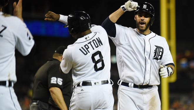 Tigers' Justin Upton, left, celebrates with J.D. Martinez after Martinez's grand slam in the seventh inning to give the Tigers a 8-7 lead. Detroit Tigers vs Baltimore Orioles at Comerica Park in Detroit on May 16, 2017. 