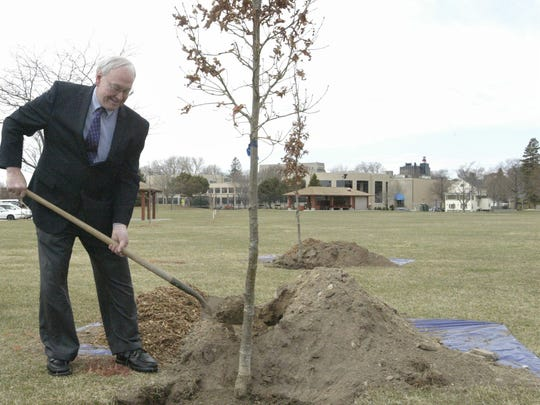 "Sheboygan Mayor Mike Vandersteen helps plant one of the new crimson spire English oak trees Friday, April 27, 2018, in Deland Park in Sheboygan, Wis. The city was honored that day with a ""Tree City USA"" title from the national Arbor Day Foundation, and was Wisconsin's first city to earn the title 40 years ago."