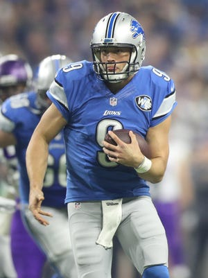 """Lions' Matthew Stafford scrambles against the Vikings. """"I'm just trying to help our team get first downs,"""" he said."""