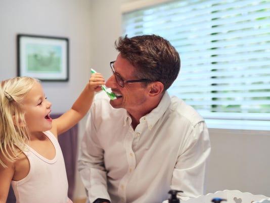 UVM Medical Center - Daughter brushing dad's teeth