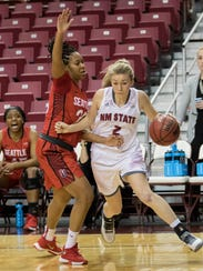 Aggies forward Brooke Salas drives the baseline against
