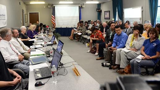 Members of the Washoe County School Board on the left and the public on the right during a 2014 meeting.