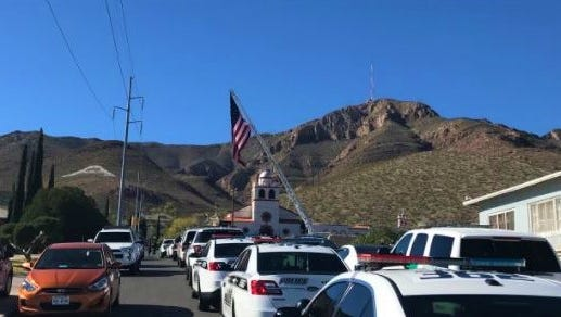 Vehicles from numerous law enforcement agencies in the borderland line the streets in front of Our Lady of Guadalupe Church in Central El Paso ahead of the funeral Mass for U.S. Border Patrol Agent Rogelio Martinez on Saturday.