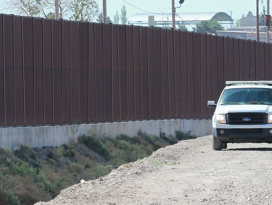 In this 2016 El Paso Times photo, a U.S. Border Patrol vehicle is seen stationed next to the border wall along Paisano Drive in West El Paso.