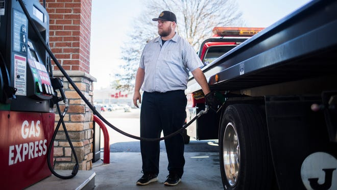 Rick Truman, tow truck driver at Action Towing, fuels his truck on Thursday, February 16, 2017 in Anderson.