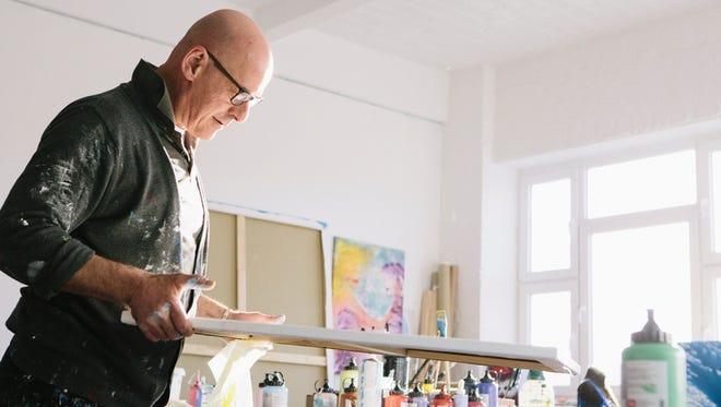 Artist works on his paintings