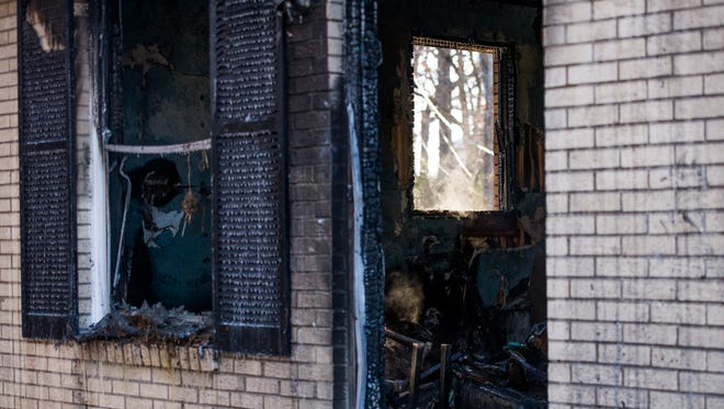 Remnants of the house fire on Mills Drive that killed 2 people in Clarksville on January 2, 2018.