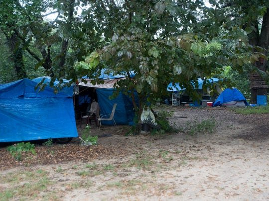 Small campsites dot Sean's Outpost in the Satoshi Forest on Monday, Oct. 2, 2017. The camp offers refuge for the homeless.