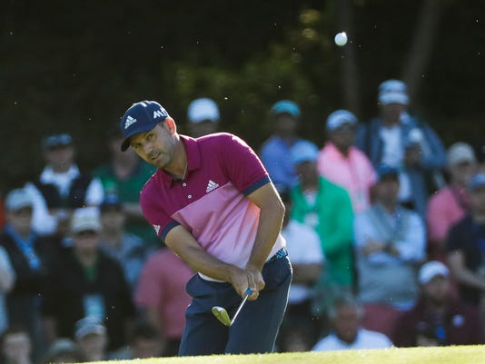 Sergio Garcia, of Spain, chips to the 15th green during the third round of the Masters golf tournament Saturday, April 8, 2017, in Augusta, Ga. (AP Photo/David J. Phillip)