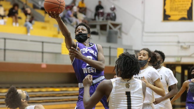 Topeka West senior Marque Wilkerson shoots a lay up against Topeka High in the second quarter of Friday's game at Topeka High school.