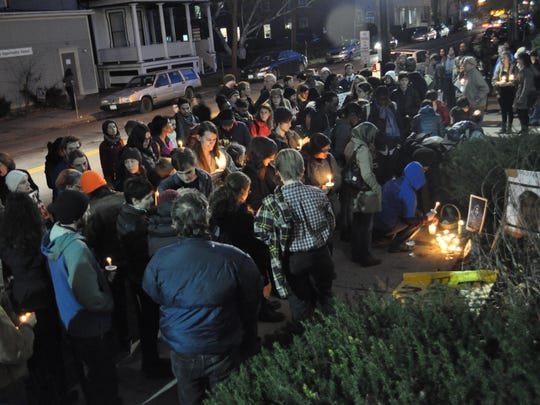 Around 100 Ithaca area residents gathered for a vigil