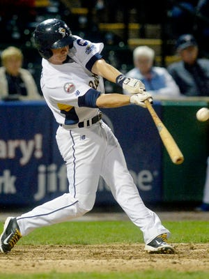 York's Bryan Pounds hits a double during a game last season. Pounds will return to the Revs 2016 squad, the team announced Friday.