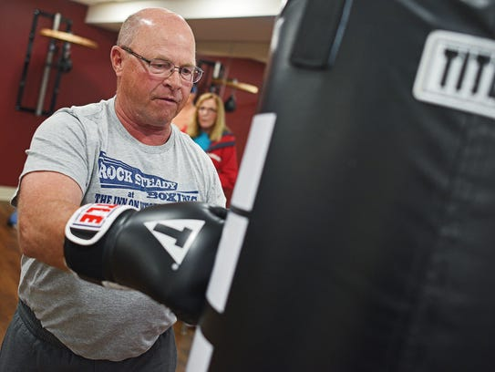 Meldon Kroeger hits a heavy bag during a grand opening