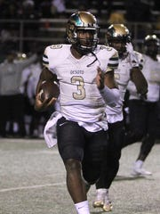 Desoto's Shawn Robinson keeps the ball and runs to the sideline in the Region I-6A Division II semifinal against Abilene Friday, Nov. 25, 2016, at Memorial Stadium in Wichita Falls.