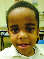 Dontez Gerald, 7, wants a camera for Christmas and Santa told him on the phone last summer that he'd better be good.