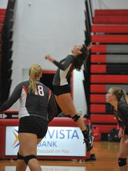 Emily Stump winds up for a kill.