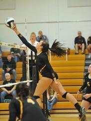 Jenna Siegel pushes one over the net against Margaretta