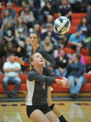 Addie Ackerman, Nancy's daughter, sets a teammate in the regional championship match.