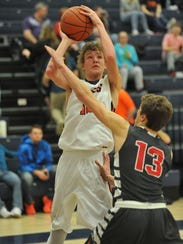 Galion's Gage Lackey puts up a jumper while guarded