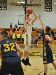 Colonel Crawford's Cameron McCreary shoots a jumper.