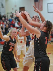 Bucyrus's Shaina Orewiler puts up a contested shot