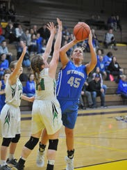 Olivia Grove puts up a contested shot with two Margaretta