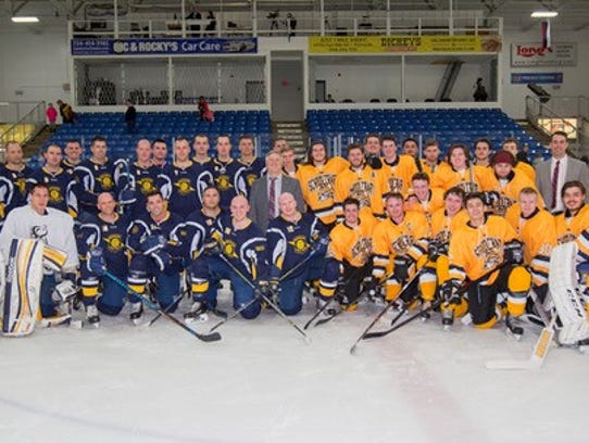 Players and coaches unite after the recent benefit