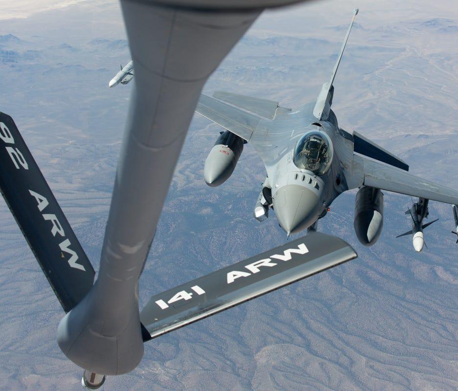 An F-16 fighter jet  approaches the refueling boom during a training mission on Nevada on July 22, 2016.