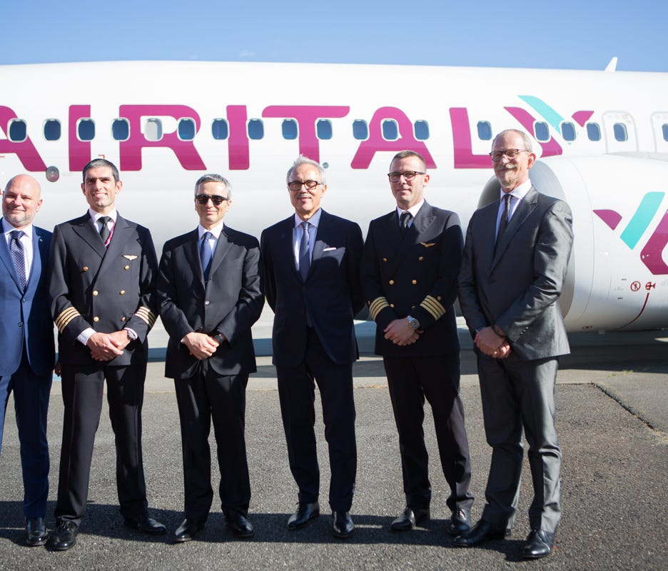 Air Italy officials and crew pose with the airline's first Boeing 737 MAX at a delivery ceremony in Everett, Wash., on May 11, 2018.