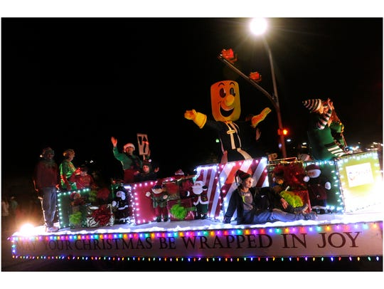 The Taylor Electric Co-op float rolls down Pine Street during the 2017 City Sidewalks Christmas Lights Parade.