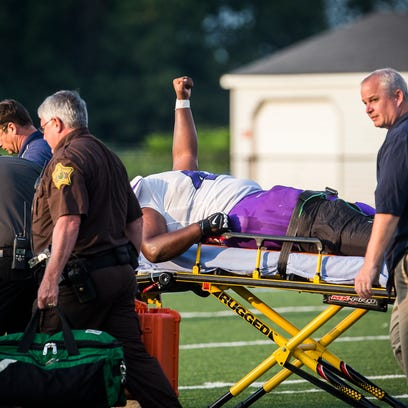 Central's DJ Pointer is carted off the field after